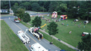 Drone photo of trucks, bounce houses, and police cars