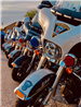 Close-up photo of fronts of a line of Police Department Motorcycles