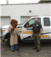 McGruff the Crime Dog gives a thumbs up to police officer