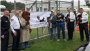 Four police officers, two residents and McGruff the Crime Dog at the Animal Shelter Open House