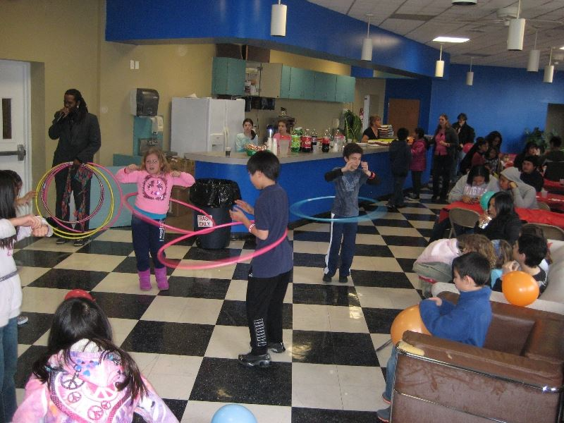 Girls and Boys Playing with Hula Hoops