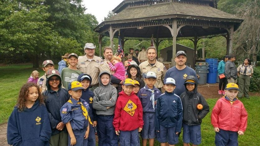 Livingston Cub Scouts and their leaders smile for a photo.