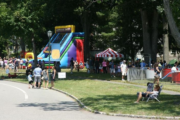 Families enjoy a sunny July 4th on the Oval. Pictured: bouncy slide!