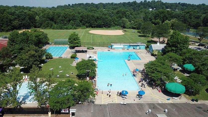 Aerial photo of Haines Pool with people swimming after the Patriotic Ceremony