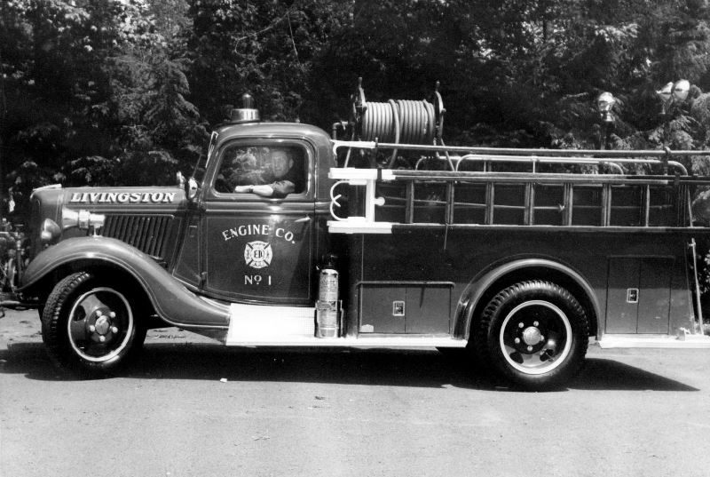 Antique Fire Engine With Deputy Chief Jack McGee at the Wheel
