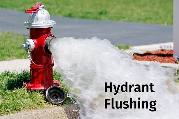 Fire hydrant being flushed as part of an important routine maintenance program