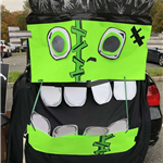 Car decorated as a silly, bright green Frankenstein's monster for Trunk or Treat at Fright Night