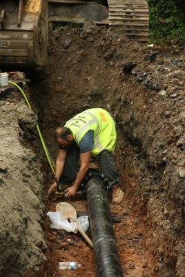 DPW employee works on water main replacement